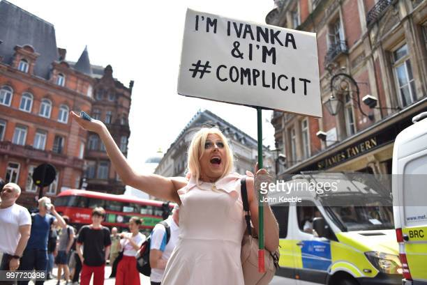 Demonstrator with a placard saying 'I'm Ivanka i'm #complicit' attends the Drag Protest Parade LGBTQi March against Trump on July 13 2018 in London...