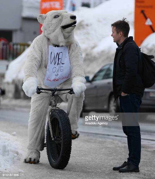 A demonstrator with a polar bear costume protests US President Donald J Trump during the 48th World Economic Forum in Davos Switzerland on January 25...