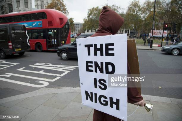 Demonstrator with a sandwich board reading The End Is Nigh protests in Westminster on Budget Day on 22nd November 2017 in London England United...