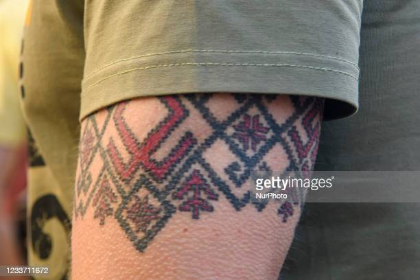 Demonstrator with a tattoo on his arm in the form of a traditional Ukrainian pattern during an anti-presidential rally outside the President's office...