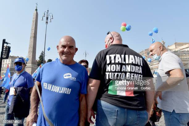 Demonstrator with a T-shirt with the words: Italians, it's not going to be all right, in Piazza del Popolo to take part in the CGIL, CISL and UIL...