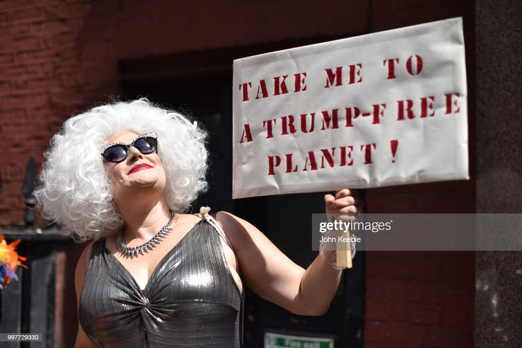 A Demonstrator with an anti Trump placard saying 'Take me to a Trump free planet' attends the Drag Protest Parade LGBTQi March against Trump on July 13, 2018 in London, United Kingdom. Drag queens hold a mass rally in Central London against the Trump administration?s record on LGBT rights including a ban on transgender personnel. The President of the United States and First Lady, Melania Trump, touched down yesterday in the UK on Air Force One for their first official visit. Today the President will visit Prime Minister Theresa May at Chequers and take tea with the Queen at Windsor Castle.
