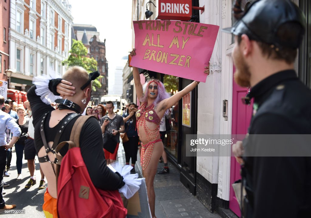 Demonstrator with an anti Trump placard saying 'Trump stole my bronzer' attends the Drag Protest Parade LGBTQi March against Trump on July 13, 2018 in London, United Kingdom. Drag queens hold a mass rally in Central London against the Trump administration?s record on LGBT rights including a ban on transgender personnel. The President of the United States and First Lady, Melania Trump, touched down yesterday in the UK on Air Force One for their first official visit. Today the President will visit Prime Minister Theresa May at Chequers and take tea with the Queen at Windsor Castle.