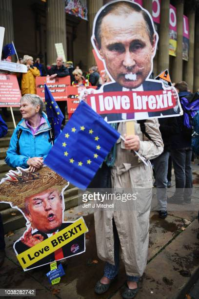 Demonstrator with an effigy of US President Donald Trump and Russian President Vladimir Putin on the March For The Many on September 23 2018 in...
