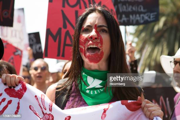A demonstrator with her face painted shouts slogans during a rally on International Women's Day in Mexico City Mexico on Friday March 8 2020 The...