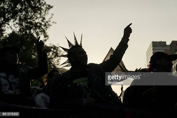 A demonstrator with his hair styled in a mohawk shouts slogans during a protest against the gasoline price hike in Mexico City Mexico on Monday Jan 9...
