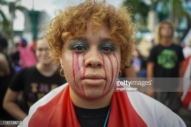 Demonstrator with make up depicting tears running down her face before the start of a massive march on July 22, 2019 in San Juan, Puerto Rico. There...