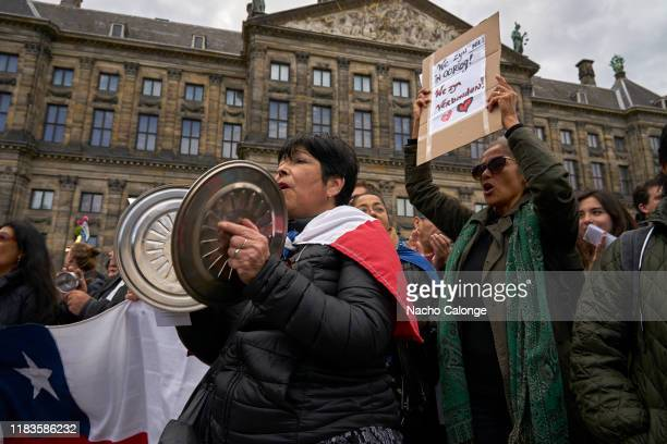 A demonstrator with the chili flag on her back protests during the demonstration that was organized today in Amsterdam in support of the Chilean...