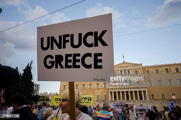A demonstrator with the message 'Unfuck Greece' Greeks gathered in Syntagma square demanding dignity and to stop the austerity measures imposed in...