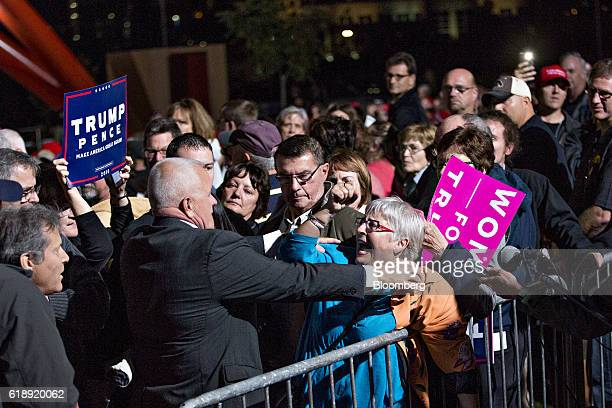 A demonstrator yells at a security guard during a campaign rally with Donald Trump 2016 Republican presidential nominee in Cedar Rapids Iowa US on...