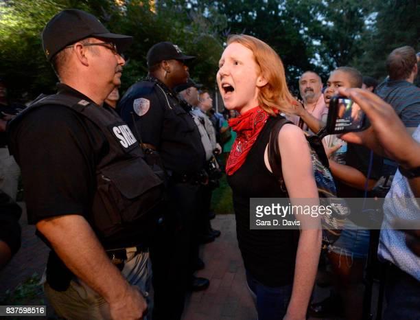 A demonstrator yells at a sheriff deputy during a rally for the removal of a Confederate statue coined Silent Sam on the campus of the University of...