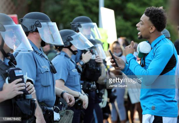 Demonstrator yells at police officers during a protest on May 31, 2020 in Kansas City, Missouri. Protests erupted around the country in response to...