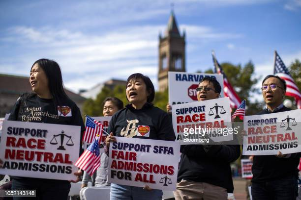 Demonstrators against Harvard University's admission process hold signs and American flags while gathering during a protest at Copley Square in...