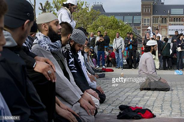 Demonstrators against the controversial USproduced film mocking Islam Innocence of Muslims pray on the Museumplein in Amsterdam on September 16 2012...