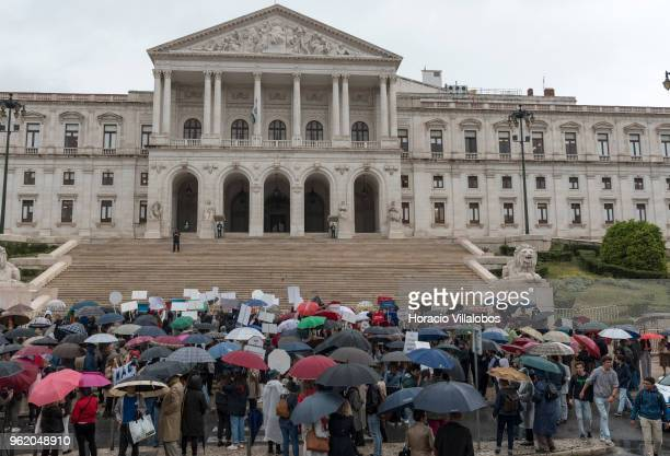 Demonstrators against the passing of euthanasia legislation gather under the rain outside the Portuguese Parliament on May 24, 2018 in Lisbon,...