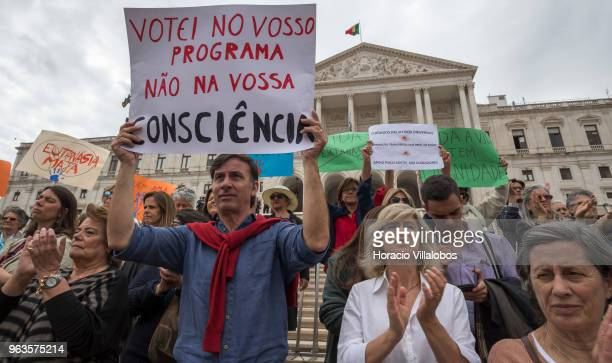Demonstrators against the passing of euthanasia legislation gather outside the Portuguese Parliament during the parliamentary debate on May 29 2018...