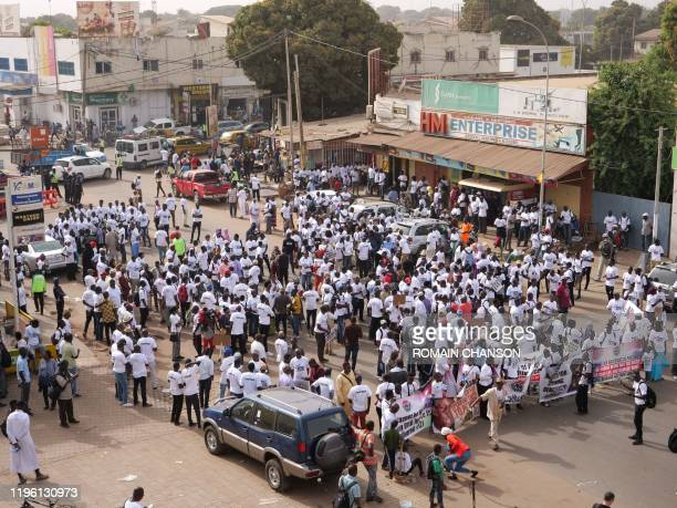 Demonstrators against the regime of Yahya Jammeh, the former President of the Gambia, gather in the streets during a demonstration asking for Yahya...