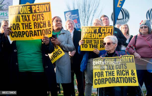 Demonstrators against the Republican tax reform bill hold a 'Peoples Filibuster to Stop Tax Cuts for Billionaires' protest rally outside the US...