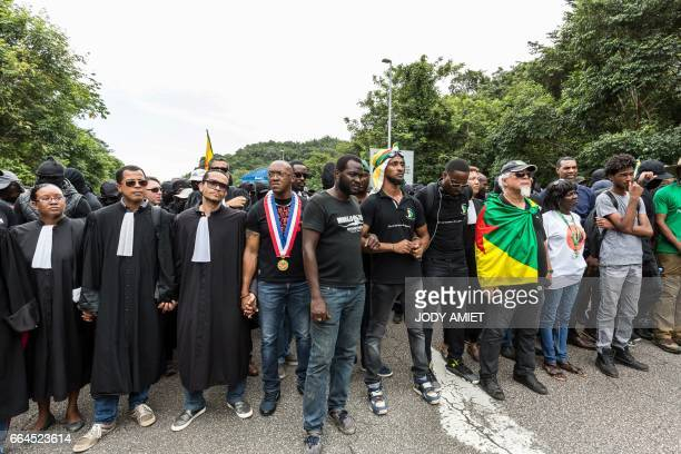 Demonstrators among which a delegation of lawyers stand during a protest over security and the state of the economy near Kourou space center on April...
