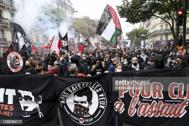 Demonstrators and anti-fascist activists hold banners depicting Clement Meric during a demonstration in Paris, on June 5 a day after two ex-skinheads...