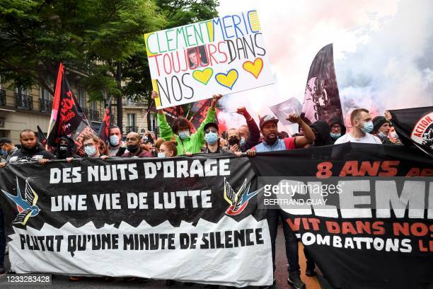 """Demonstrators and anti-fascist activists hold banners reading """"Clement Meric forever in our hearts"""" and """"Storm nights and a life of struggle, rather..."""