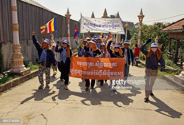 Demonstrators and buddhist monks start to march from a local wat situated 35 kilometers away from Phnom Penh along the National Road one on December...