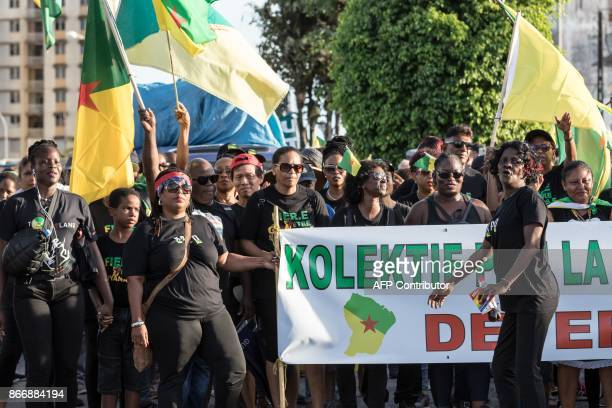 Demonstrators and members of the 500 brothers collective march in Cayenne, French Guiana, on October 26 during an official visit by French President...