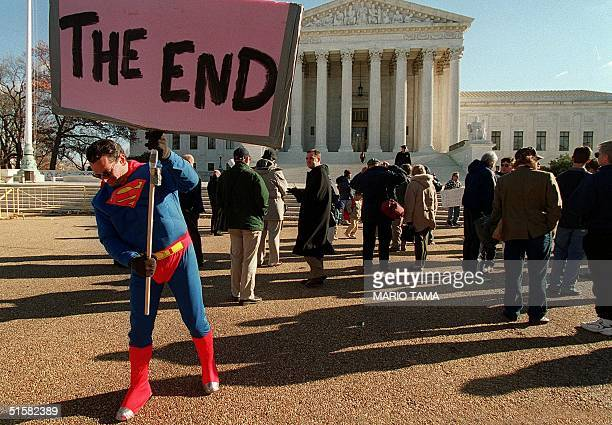 Demonstrators and onlookers including Scott LoBaido dressed as the comic book hero Superman stand in front of the US Supreme Court 12 December 2000...