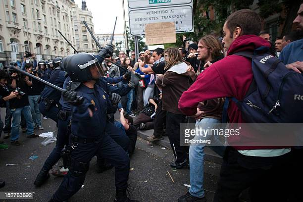 Demonstrators and police clash during a protest against the government's austerity measures in the city centre of Madrid Spain on Tuesday Sept 25...