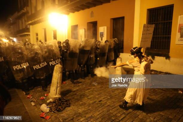 Demonstrators and police face off during a protest against Ricardo Rossello the governor of Puerto Rico on July 17 2019 in Old San Juan Puerto Rico...