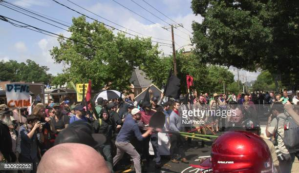 Demonstrators and protesters clash during the Unite the Right free speech rally at Emancipation Park in Charlottesville Virginia USA on August 12 2017