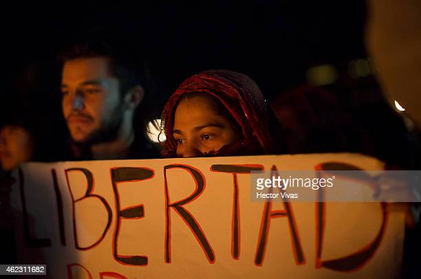Demonstrators and relatives of the 43 missing students from Ayotzinapa take part in a global action on January 26 2015 in Mexico City Mexico The...