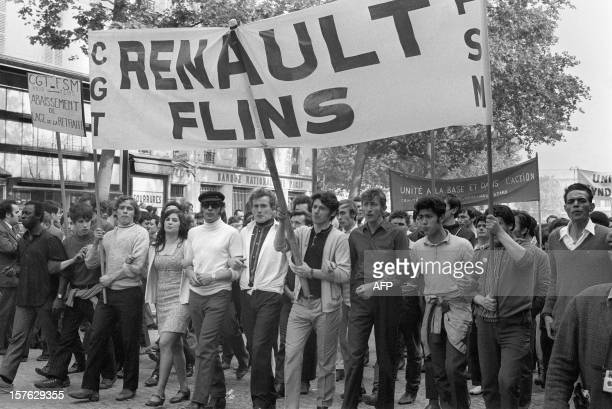 Demonstrators and Renault car factory of Flins workers parade 28 May 1968 in Paris' streets during the huge antigovernment rally organized by the...