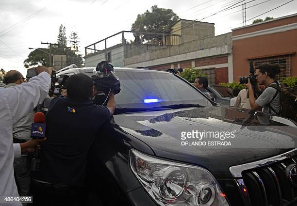 Demonstrators and the media surround the vehicle carrying former Guatemalan President Otto Perez upon arrival at the Matamoros military barracks in...
