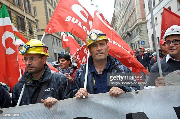 Demonstrators and workers belonging to Italian trade unions protest in the streets against the pension reform launched by the government of Mario...