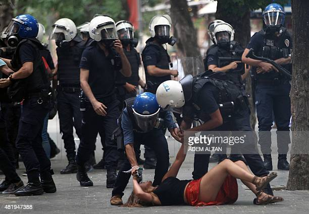 Demonstrators are detained by Turkish police officers during a protest condemning a suicide bombing that killed 32 activists on July 20 in the...