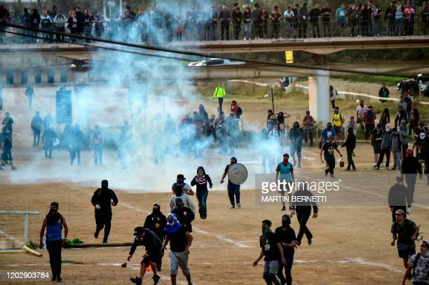 Demonstrators are dispersed with tear gas during a protest against Chilean President Sebastian Pinera's government in Vina del Mar, on February 23...