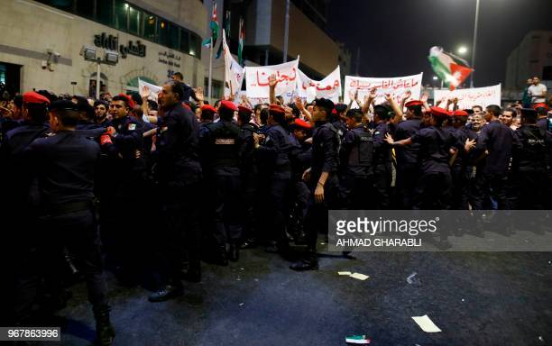 Demonstrators are pushed by Jordanian antiriot police and security forces during a protest near the prime minister's office in Amman Jordan on June 5...