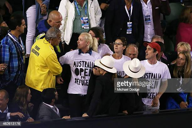Demonstrators are removed from Rod Laver Arena after they protested for the closure of an offshore detention centre on Manus Island during day 14 of...