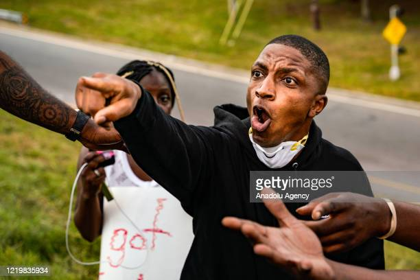 Demonstrators are seen as they set on fire a restaurant during the protest after an Atlanta police officer shot and killed Rayshard Brooks at a...