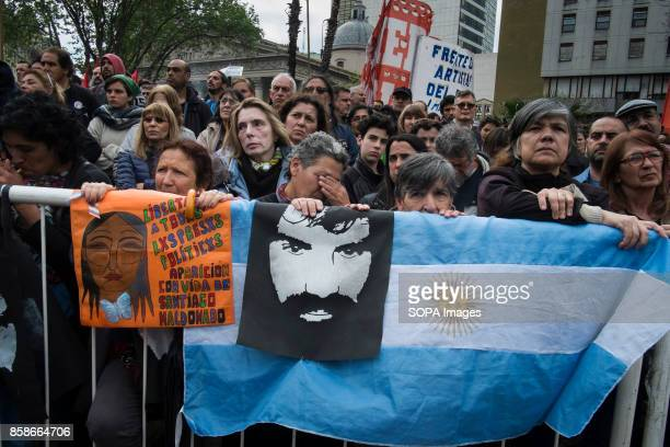 Demonstrators are seen gathering to protest against the disappearance of Santiago Maldonado since 1 August 2017 while holding an Argentina flag and a...