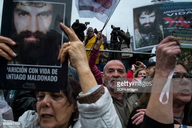 Demonstrators are seen holding several placards to protest against the disappearance of Santiago Maldonado since 1 August 2017 Despite the rain...