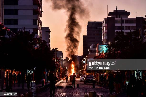 Demonstrators are seen in a barricade during a protest against Chilean President Sebastian Pinera's government in Vina del Mar, on February 23 during...