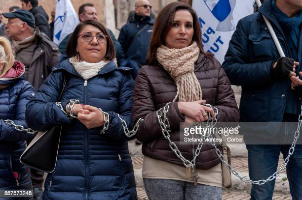 Demonstrators are seen in chains during the demonstration of drivers of tourist buses in Capitol against the new regulation for tourist buses...