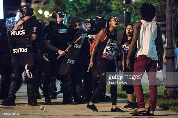 Demonstrators argue amongst themselves during protests September 22 2016 in downtown Charlotte NC The North Carolina governor has declared a state of...