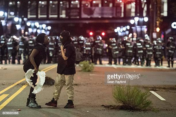 Demonstrators argue during protests on September 21 2016 in downtown Charlotte NC The North Carolina governor has declared a state of emergency in...