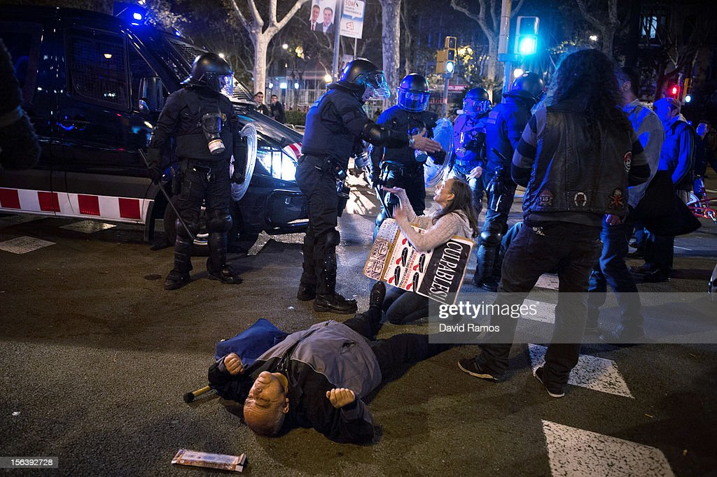Demonstrators argues with riot police officers as they block a street during clashes at the end of a 24-hour strike on November 14, 2012 in Barcelona, Spain. Spain's trade unions have called the second general strike during Mariano Rajoy's presidency. With the country's unemployment rate set at 25 per cent, demonstrators from social movements are expected to join striking public sector workers to protest against austerity cuts and labour reforms.