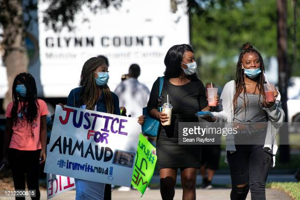 Demonstrators arrive to protest the shooting death of Ahmaud Arbery at the Glynn County Courthouse on May 8, 2020 in Brunswick, Georgia. Gregory...