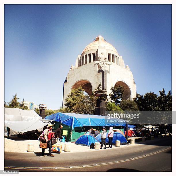 Demonstrators arriving at the tent city around the Monumento A la Revolución the monument to the revolution of 1910 Teachers are occupying downtown...