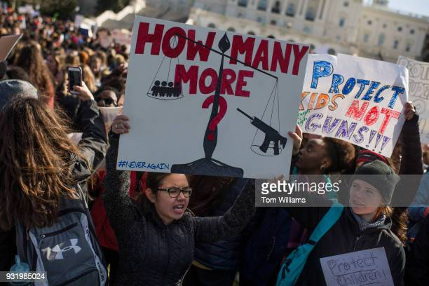 Demonstrators assemble for a rally on the West Front of the Capitol to call on Congress to act on gun violence prevention during a national walkout...